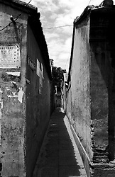 Very narrow alleyway between two houses in Beijing