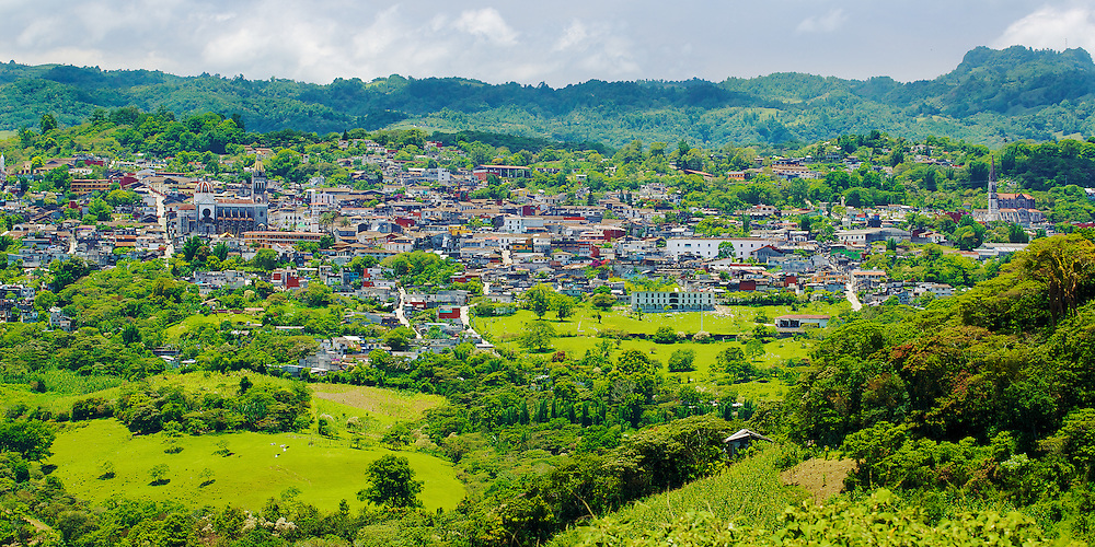 The town of Cuetzalan nestles into the hillside, México.