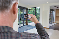 Real estate agent photographing new property