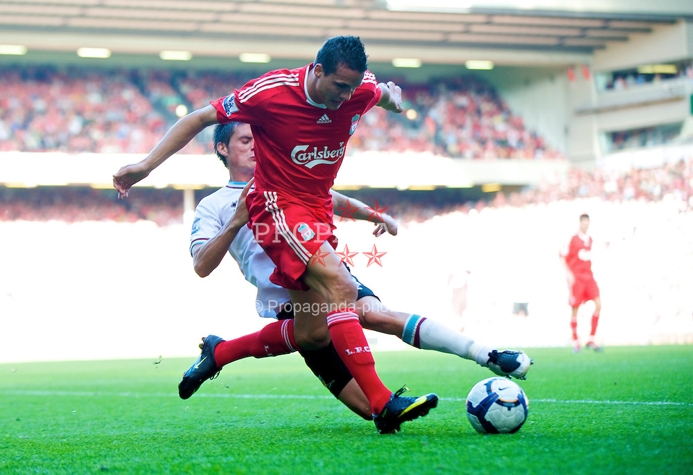 LIVERPOOL, ENGLAND - Saturday, September 12, 2009: Liverpool's Philipp Degen and Burnley's Stephen Jordan during the Premiership match at Anfield. (Photo by David Rawcliffe/Propaganda)