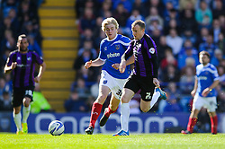 David Clarkson (SCO) of Bristol Rovers is challenged by Jack Whatmough (ENG) of Portsmouth - Photo mandatory by-line: Rogan Thomson/JMP - 07966 386802 - 19/04/2014 - SPORT - FOOTBALL - Fratton Park, Portsmouth - Portsmouth FC v Bristol Rovers - Sky Bet Football League 2.