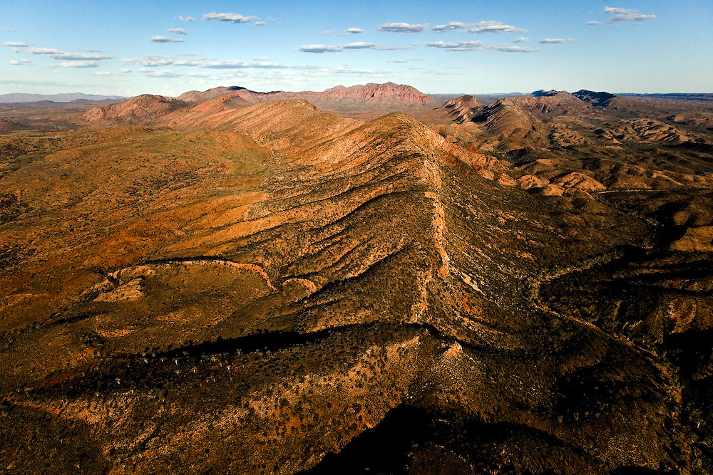 Mt Giles is the eastern border of Ormiston Pound, seen from above Mt Sonder, with the West MacDonnell Ranges stretching east toward Alice Springs