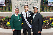 Ohio University President, Roderick McDavis, and Ohio University First Lady, Deborah McDavis, pose with Michael Jones, a member of Ohio University's Homecoming Court, at the College Gateway on October 8, 2016.