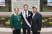 Ohio University President, Roderick McDavis, and Ohio University First Lady, Deborah McDavis, pose with Michael Jones, a member of Ohio University's Homecoming Court, at the College Gateway on October 8, 2016.
