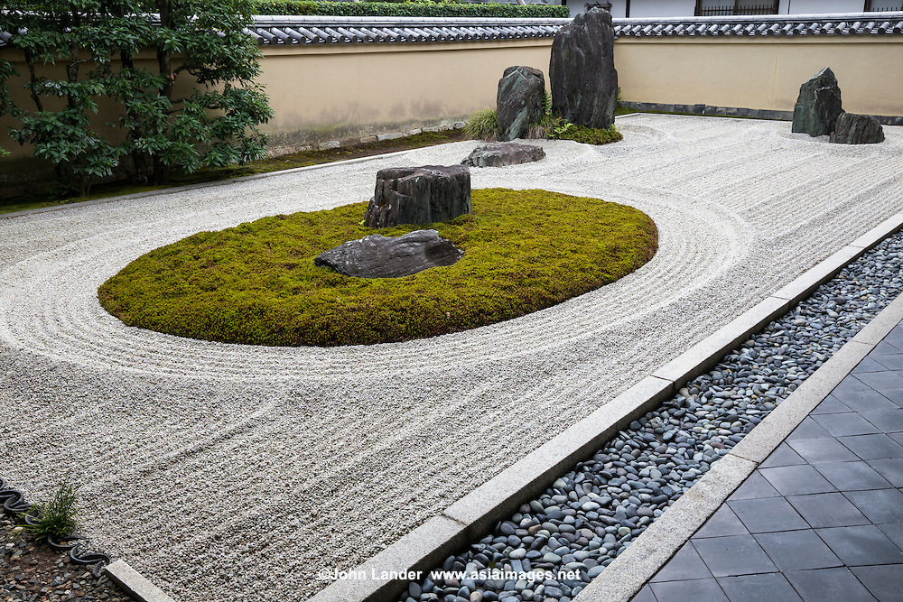 "Ryogintei at Ryogen-in is a very unique moss garden within a Zen garden. The moss shows the waters and the stone projectied from the center symbolises ""Shumisen"" -  core of the Universe. In Buddhism this Universe is thought to consist of eight seas and nine mountains."