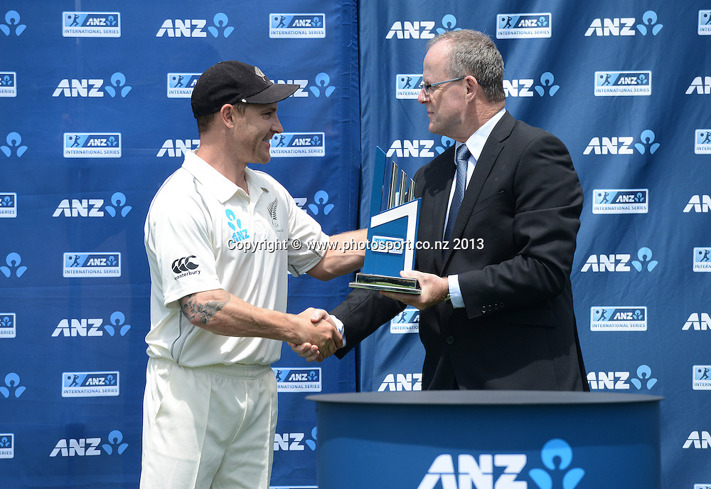 Brendon McCullum is presented with the ANZ trophy after a 2-0 series win over the West Indies on Day 4 of the 3rd cricket test match of the ANZ Test Series. New Zealand Black Caps v West Indies at Seddon Park in Hamilton. Sunday 22 December 2013. Photo: Andrew Cornaga / www.Photosport.co.nz