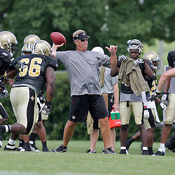 04 August 2009: Saints defensive coordinator throws a pass in a drill during New Orleans Saints training camp at the team's practice facility in Metairie, Louisiana.