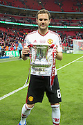 Juan Mata of Manchester United with the FA Cup during the The FA Cup Final between Crystal Palace and Manchester United at Wembley Stadium, London, England on 21 May 2016. Photo by Phil Duncan.