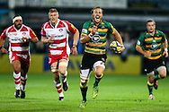 James Wilson of Northampton Saints (second right) makes a break during the Aviva Premiership match at Franklin's Gardens, Northampton<br /> Picture by Andy Kearns/Focus Images Ltd 0781 864 4264<br /> 05/09/2014