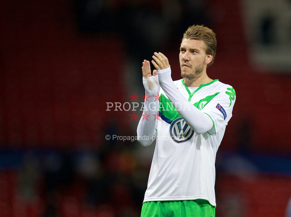 MANCHESTER, ENGLAND - Wednesday, September 30, 2015: VfL Wolfsburg's Nicklas Bendtner applauds the travelling German supporters after his side's 2-1 defeat to Manchester United during the UEFA Champions League Group B match at Old Trafford. (Pic by David Rawcliffe/Propaganda)