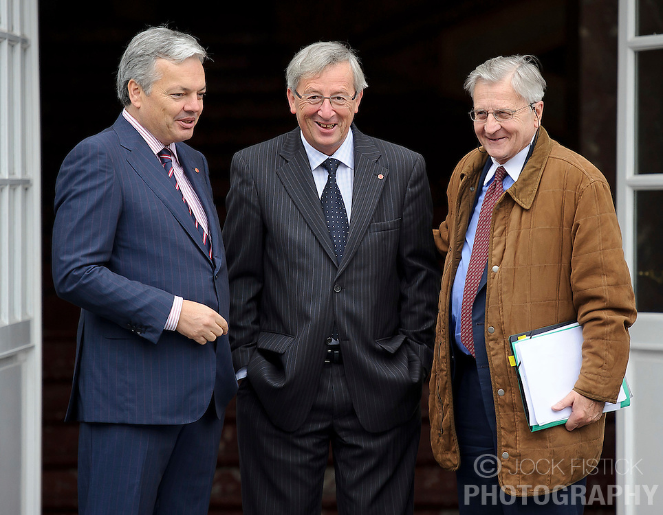 Jean-Claude Juncker, Luxembourg's prime minister, and president of the Eurogroup, center, and Didier Reynders, Belgium's finance minister, left, greet Jean-Claude Trichet, president of the European Central Bank, as he arrives for the Eurogroup meeting in Brussels, Thursday Sept. 30, 2010. (Photo © Jock Fistick)