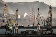 Industrial scene. Chimneys and cranes in the Russian Black Sea port of Novorossiysk