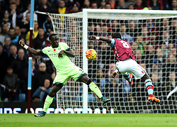 Idrissa Gueye of Aston Villa shoots past Manchester City's Bacary Sagna but wide of the goal - Mandatory byline: Robbie Stephenson/JMP - 07966 386802 - 08/11/2015 - FOOTBALL - Villa Park - Birmingham, England - Aston Villa v Manchester City - Barclays Premier League