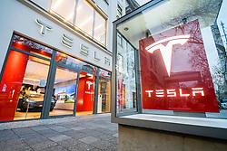 Glass display cabinet for Tesla car showroom on famous shopping street Kurfurstendamm , Kudamm, in Berlin, Germany.