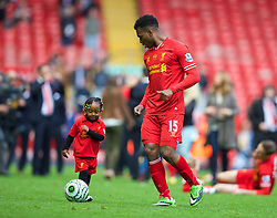 LIVERPOOL, ENGLAND - Sunday, May 11, 2014: Liverpool's Daniel Sturridge with a young child after the Premiership match at Anfield. (Pic by David Rawcliffe/Propaganda)