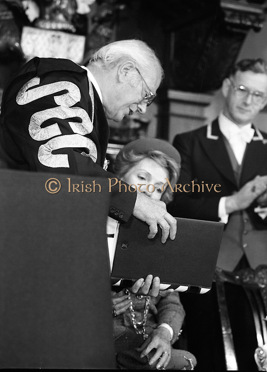 Nancy Reagan .Visits the Royal College Of Surgeons..St Stephens Green,.1984..04.06.1984.06.04.1984.4th June 1984..Nancy Reagan visited the Royal College of Surgeons where she unveilled a portrait of her late father.Her father, Dr Loyal Davis was an Honorary Fellow of the college. Mrs Reagan then presented the portrait to the college..Photo of Mrs Reagan as she is presented with a commerative book by Professor Eoin O'Malley.