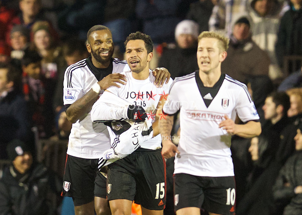LONDON, ENGLAND - Wednesday, February 12, 2014: Fulham's Kieran Richardson celebrates scoring the second goal against Liverpool by revealing a shirt with a bible reference 'John 3:16' during the Premiership match at Craven Cottage. (Pic by David Rawcliffe/Propaganda)