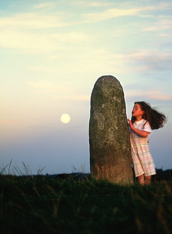 The Lia Fail, crowning stone of the high kings of Ireland, full moon rising. Ancient ritual site of Tara, County Meath, Ireland.