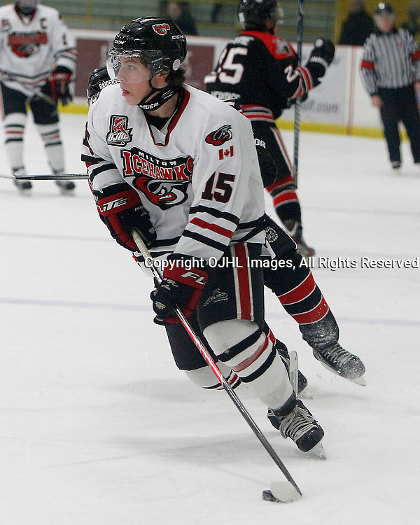 GEORGETOWN, ON - Oct 5 : Ontario Junior Hockey League Game Action between the Milton Ice Hawks and the Georgetown Raiders, TJ Fergus #15 of the Milton Icehawks Hockey Club skates with the puck.<br /> (Photo by Brian Watts / OJHL Images)