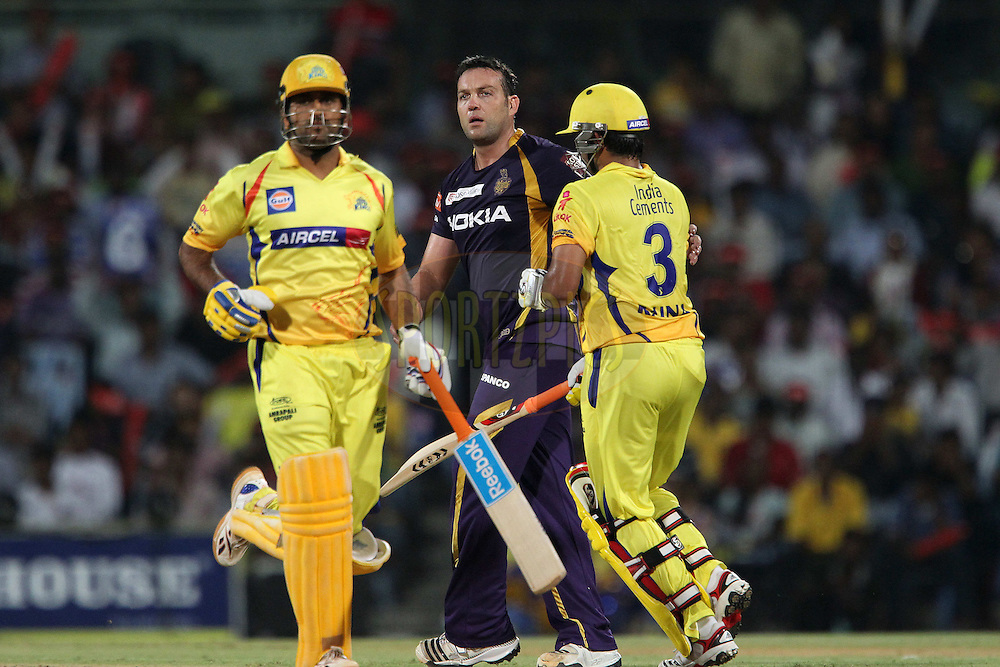 Jacques Kallis lokks on as Suresh Raina and MS Dhoni make the run during match 41 of the the Indian Premier League ( IPL) 2012  between The Chennai Superkings and the Kolkata Knight Riders held at the M. A. Chidambaram Stadium, Chennai on the 30th April 2012..Photo by Ron Gaunt/IPL/SPORTZPICS