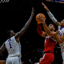 Jan 13, 2018; Baton Rouge, LA, USA; Alabama Crimson Tide forward Braxton Key (25) shoots over LSU Tigers forward Duop Reath (1) and guard Brandon Sampson (0) during the first half at the Pete Maravich Assembly Center. Mandatory Credit: Derick E. Hingle-USA TODAY Sports