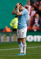 Manchester City's James Milner shows his frustration - Photo mandatory by-line: Matt Bunn/JMP - Tel: Mobile: 07966 386802 14/09/2013 - SPORT - FOOTBALL -  Britannia Stadium - Stoke-On-Trent - Stoke City V Manchester City - Barclays Premier League