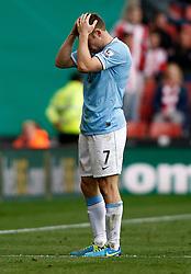 Manchester City's James Milner shows his frustration - Photo mandatory by-line: Matt Bunn/JMP - Tel: Mobile: 07966 386802 14/09/2013 - SPORT - FOOTBALL -  Britannia Stadium - Stoke-On-Trent - Stoke City V Manchester City - Barclays Premier League