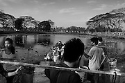 People waiting in a queue for their turn to gather water from the pond. At Dala, Yangon Division, Myanmar, 16th February, 2014.