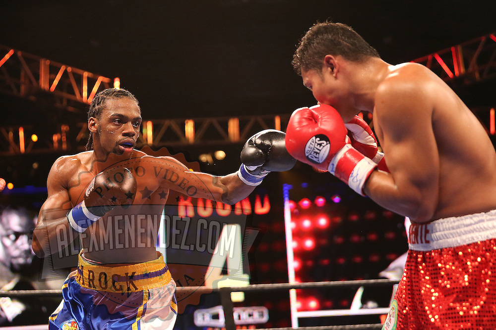 WINTER PARK, FL - AUGUST 02: John Jackson (L) fights against Dennis Laurente during the Premier Boxing Champions on Bounce TV boxing match at Full Sail University - Ebbs Auditorium on August 2, 2015 in Winter Park, Florida.  (Photo by Alex Menendez/Getty Images) *** Local Caption *** John Jackson; Dennis Laurente