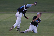 Pennsylvania's Jake Granteed making the catch over left-fielder Eric Walkowiak during the opening round of the Mid-Atlantic Senior League regional tournament held in West Deptford on Friday, August 5.