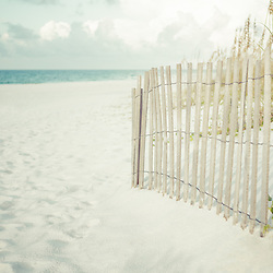 Photo of a beach fence on Casino Beach in Pensacola Beach Florida. Pensacola Beach is a coastal city in the Emerald Coast area of the Southeastern United States. Copyright ⓒ 2018 Paul Velgos with All Rights Reserved.