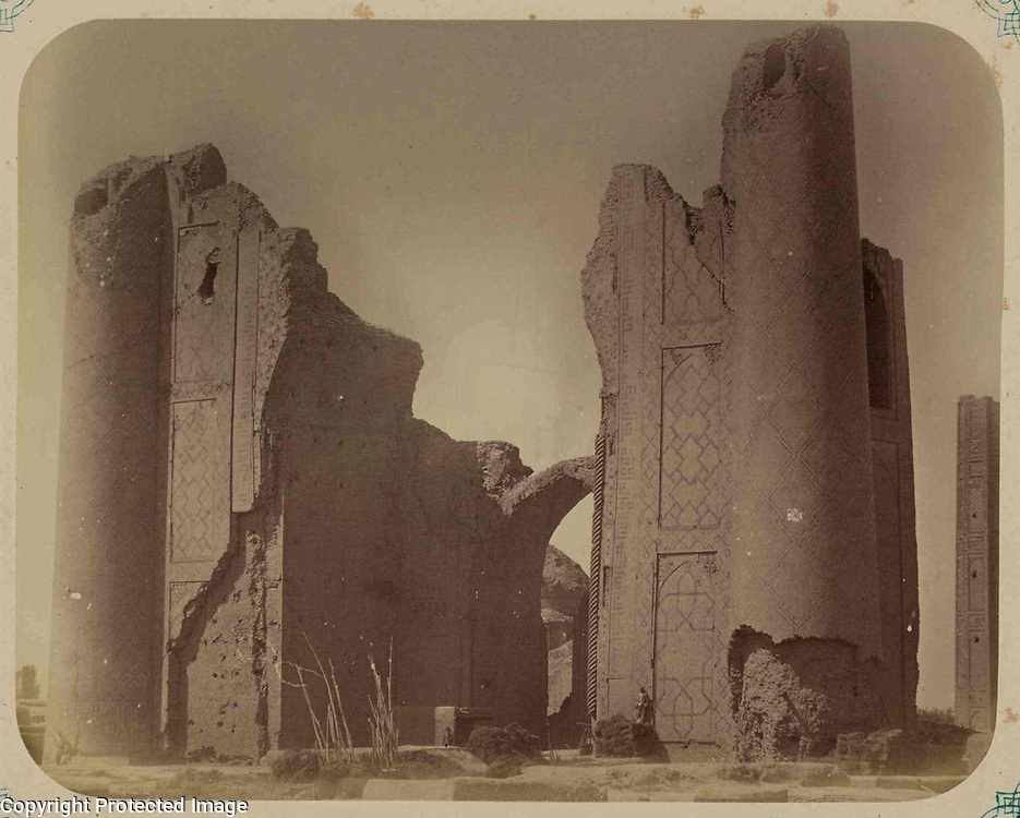 1865<br /> This photograph of the Bibi Khanym entrance structure in Samarkand (Uzbekistan) is from the archeological part of Turkestan Album. The six-volume photographic survey was produced in 1871-72, under the patronage of General Konstantin P. von Kaufman, the first governor-general (1867-82) of Turkestan, as the Russian Empire's Central Asian territories were called. The album devotes special attention to Samarkand&rsquo;s Islamic architecture, such as 14th- and 15th-century monuments from the reign of Timur (Tamerlane) and his successors. Built in 1399-1405 with the spoils of Timur&rsquo;s campaign in India, the Bibi Khanym ensemble was designated the city&rsquo;s main mosque and named in homage to Timur&rsquo;s senior wife, Sarai Mulk Khanym (bibi meaning &ldquo;lady&rdquo; or &ldquo;mother&rdquo;). Intended to be one of the largest mosques in the Islamic world, the ensemble included not only the main mosque and flanking mosques, but also a grand structure that served as an entrance to the primary courtyard. Despite damage from seismic activity over the centuries, the monumental entrance arch still stands within the hulk of the ruined flanking towers, whose brick walls show the remains of tile decoration in geometric patterns. This view is taken from the exterior of the ensemble, with the dome of a secondary mosque visible in the courtyard through the arch. A corner of the main mosque is at the far right.