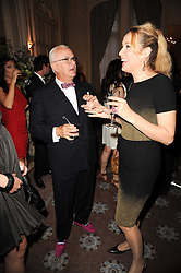 MANOLO BLAHNIK and JERRY HALL at a dinner hosted by Vogue in honour of photographer David Bailey at Claridge's, Brook Street, London on 11th May 2010.