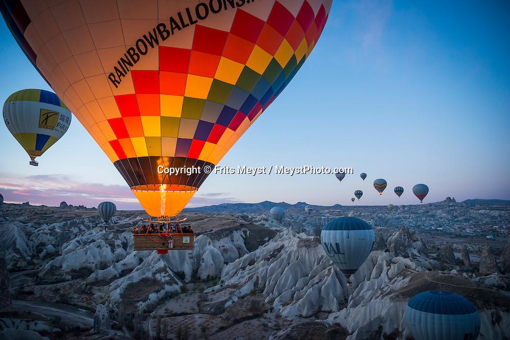 Goreme National Park, Cappadocia, Turkey, November 2015. Hot air ballooning over the tuffstone valleys and fairy chimneys of Cappadocia is the most popular activity for Tourists in Kapadokya. Photo by Frits Meyst / MeystPhoto.com