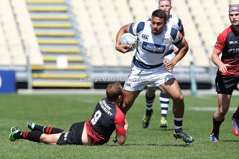 George Moala of Auckland is tackled by Andy Ellis of Canterbury during the ITM Cup Premiership Semi Final between Canterbury and Auckland at AMI Stadium on October 19, 2013 in Christchurch, New Zealand. Photo: Martin Hunter/www.photosport.co.nz