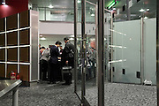 passport check at entrance to passengers embarking waiting area Heathrow airport England