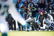 January 17, 2016: Carolina Panthers vs Seattle Seahawks. Russell Wilson evades Kawann Short