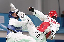 BUENOS AIRES, Oct. 12, 2018  Nisar Ahmad Abdul Rahimzai (L) of Afghanistan competes with Mohammadali Khosrarvi of Iran during the men's +73kg semifinal of taekwondo event at the 2018 Summer Youth Olympic Games in Buenos Aires, Argentina on Oct. 11, 2018. Nisar Ahmad Abdul Rahimzai lost 16-19 and took the bronze. (Credit Image: © Li Ming/Xinhua via ZUMA Wire)