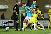 Forest Green Rovers Matthew Worthington(21) is tackled by Cheltenham Town's Chris Clements(26) during the EFL Trophy match between Forest Green Rovers and Cheltenham Town at the New Lawn, Forest Green, United Kingdom on 4 September 2018.