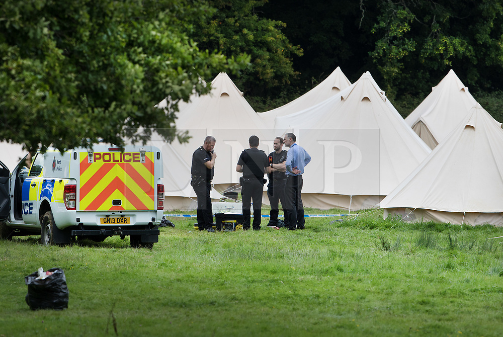 © Licensed to London News Pictures. 22/08/2017. London, UK. Police stand outside tents at the Flamefest site near Tunbridge Wells in Kent where a man died and a woman was taken to hospital over the weekend. Over 200 people attended the adult sex festival with tickets costing £600 each. The incident  is currently being treated as unexplained. Photo credit: Peter Macdiarmid/LNP