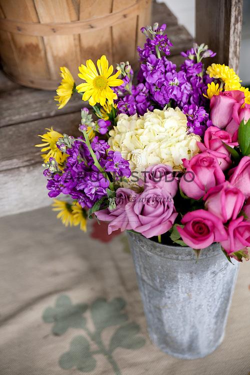 Vintage potting bench, fresh cut flowers in zinc bucket
