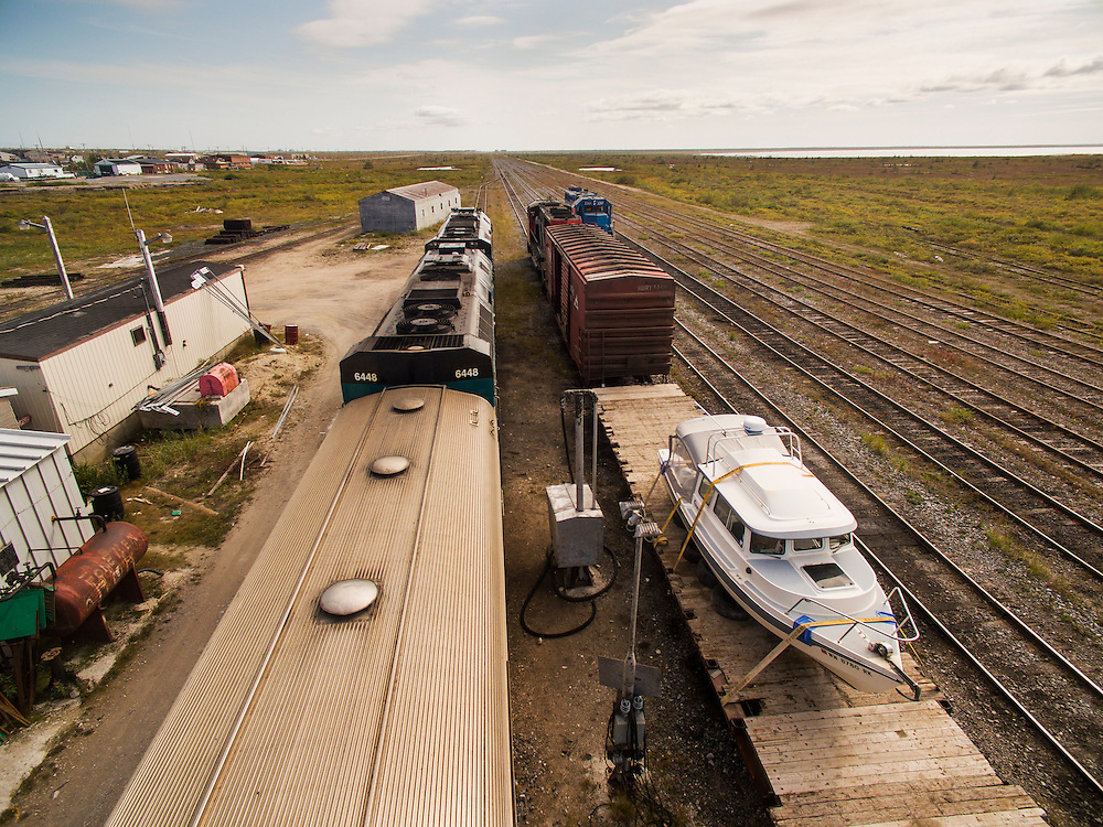 Canada, Manitoba, Churchill, Aerial view of C-Dory expedition boat loaded on Hudson Bay Railroad flat car during trip south.