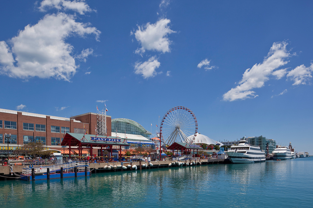 Navy Pier, Chicago Tourists and locals flock to the entertainment mecca on Lake Michigan featuring the Ferris Wheel, Odyssey Cruises, Chicago Shakespeare Theater, restaurants, Harry Carey's, bars, museums.