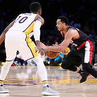 26 March 2016: Portland Trail Blazers guard CJ McCollum (3) drives past Los Angeles Lakers guard David Nwaba (10) during the Portland Trail Blazers 97-81 victory over the Los Angeles Lakers, at the Staples Center, Los Angeles, California, USA.