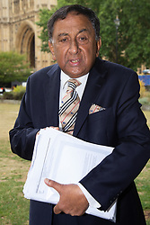 Conservative Peer Lord Mohamed Sheikh who has demanded that the Tories remove the whip from Boris Johnson following his remarks about Muslim women wearing the Burqa and Niqab, holds a bundle of hate mail he has received since. London, August 10 2018.