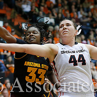 Arizona State's Charnea Johnson-Chapman, left, and Oregon State's Ruth Hamblin fight for the ball in the second half of an NCAA college basketball game in Corvallis, Ore., on Monday, Feb. 1, 2016. Oregon State won 67-44. (AP Photo/Timothy J. Gonzalez)