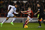 Aston Villa forward Jonathan Kodjia (26) battles with Nottingham Forest midfielder Ben Osborn (11) during the EFL Sky Bet Championship match between Nottingham Forest and Aston Villa at the City Ground, Nottingham, England on 4 February 2017. Photo by Jon Hobley.