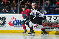 KELOWNA, CANADA - MARCH 16: Michael Farren #16 of the Kelowna Rockets stick checks Kaleb Bulych #25 of the Vancouver Giants  on March 16, 2019 at Prospera Place in Kelowna, British Columbia, Canada.  (Photo by Marissa Baecker/Shoot the Breeze)