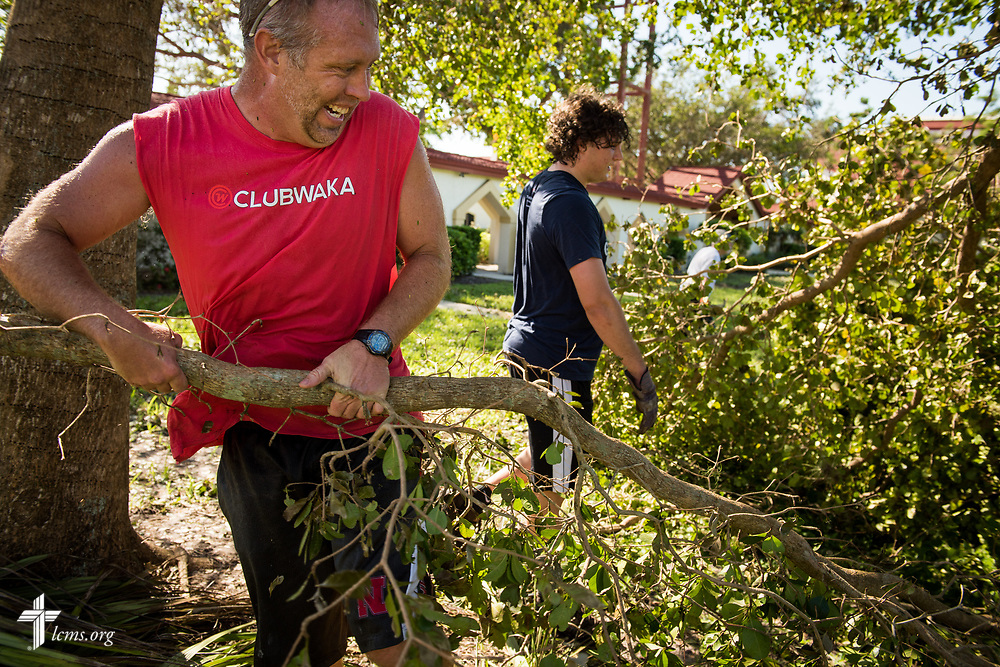 Tim Richter, director of Christian education at Zion Lutheran Church, Fort Myers, Fla., and Jack Proctor, director of Christian education at Saint Michael Lutheran Church, Fort Myers, removes fallen tree branches leftover from Hurricane Irma on Wednesday, Sept. 13, 2017. LCMS Communications/Erik M. Lunsford