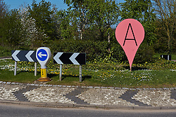 © Licensed to London News Pictures.  16/04/2014. READING, UK. A sign shaped like a life sized Google maps marker or pin has been installed on the Playhatch roundabout on the A4155 between Reading and Henley. The creator and purpose of the sign is not known. Photo credit: Cliff Hide/LNP